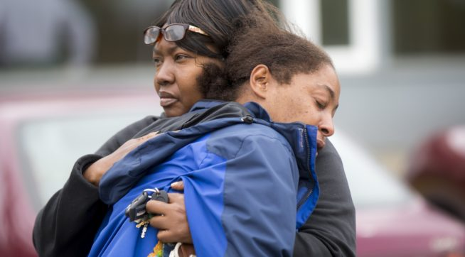 "A family member comforts Monika Williams, front, after an officer-involved shooting killed her sister at the Brettler Family Place Apartments at Magnuson Park Sunday June 18, 2017. According to police, two officers responded to a burglary call made by the woman, who they say brandished a knife at some point, and both officers shot her dead in her apartment. Children were home at the time, but physically unharmed. ""There's no reason for her to be shot in front of her babies,"" Williams yelled to reporters when she arrived on scene. ""The Seattle police shot the wrong one today."" OUTS: SEATTLE OUT, USA TODAY OUT, MAGAZINES OUT, ONLINE OUT, TELEVISION OUT, SALES OUT. MANDATORY CREDIT TO: Bettina Hansen / THE SEATTLE TIMES."