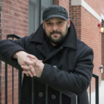 In this Jan. 9, 2017, photo, Christian Picciolini, founder of the group Life After Hate, poses for a photograph outside his Chicago home. Picciolini, a former skinhead, is an activist combatting what many see as a surge in white nationalism across the United States. He's doing it by helping members quit groups including the Ku Klux Klan and skinhead organizations. (AP Photo/Teresa Crawford)