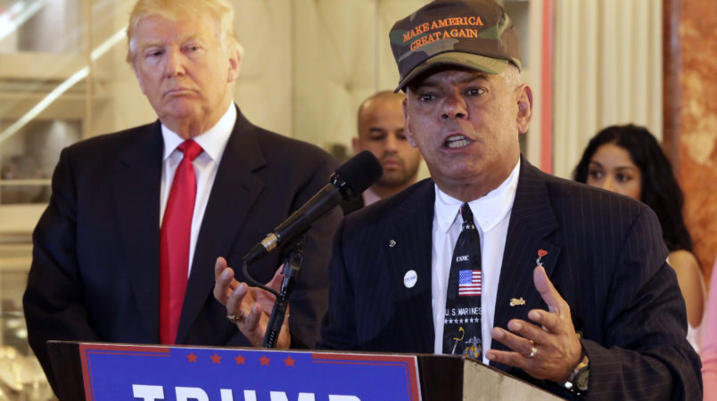 Republican presidential candidate Donald Trump listens at ;eft as Al Baldasaro, a New Hampshire state representative, speaks during a news conference in New York, Tuesday, May 31, 2016. (AP Photo/Richard Drew)