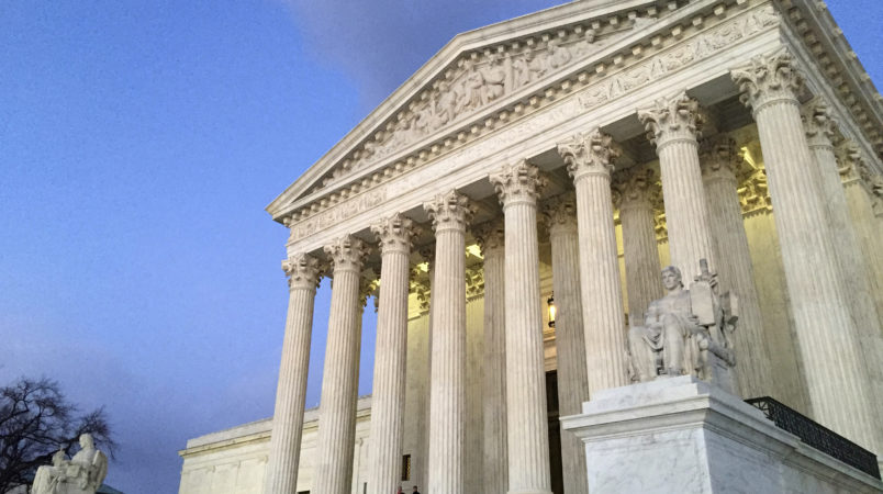 People stand on the steps of the Supreme Court at sunset on Saturday, Feb. 13, 2016, in Washington. On Saturday, Feb. 13, 2016, the U.S. Marshals Service confirmed that Scalia has died at the age of 79. (AP Photo/Jon Elswick)