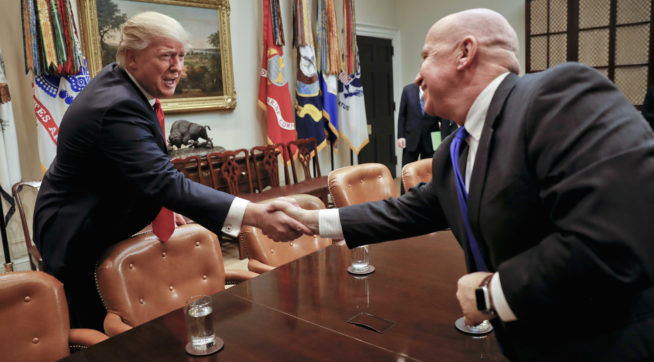 President Donald Trump shakes hands with Rep. Kevin Brady, R-Texas, right, during a meeting with House and Senate legislators in the Roosevelt Room of the White House in Washington, Thursday, Feb. 2, 2017. (AP Photo/Pablo Martinez Monsivais)