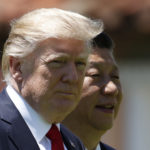 President Donald Trump and Chinese President Xi Jinping walk together at Mar-a-Lago, Friday, April 7, 2017, in Palm Beach, Fla. Trump was meeting again with his Chinese counterpart Friday, with U.S. missile strikes on Syria adding weight to his threat to act unilaterally against the nuclear weapons program of China's ally, North Korea. (AP Photo/Alex Brandon)