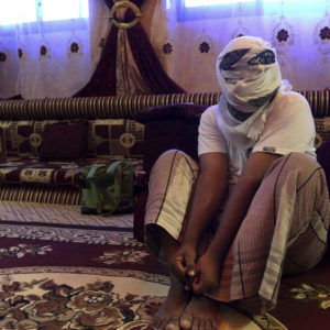 In this May 11 2017 photo, a former detainee speaks after covering his face for fear of detention. He recounted the torment he suffered in Riyan prison where hundreds of terror suspects are held without trial after being rounded up by local Yemeni forces loyal to the United Arab Emiratis in the southern city of Mukalla. Former detainees report brutal torture, and families search desperately for loved ones who have disappeared. Some including have been flown to ships in the sea and an Emirati base in the nearby Horn of Africa. (AP Photo/Maad El Zikry)