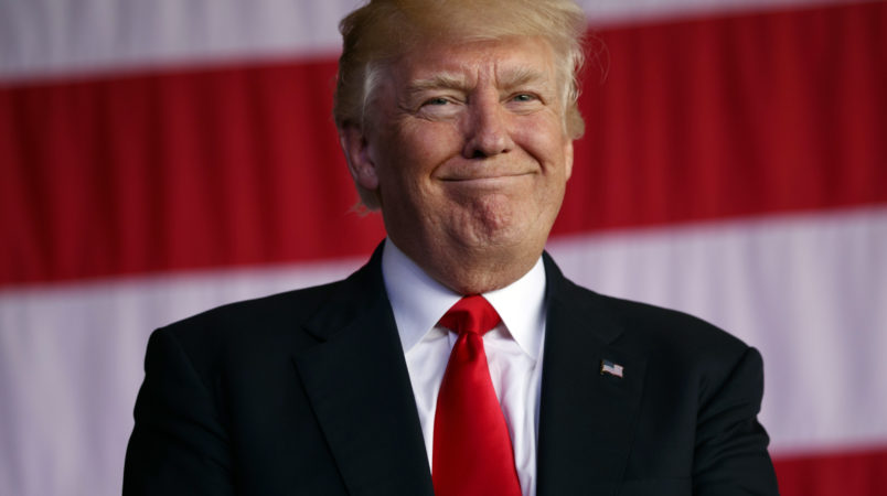 President Donald Trump smiles as he is introduced to speak to U.S. military troops and their families at Naval Air Station Sigonella, Saturday, May 27, 2017, in Sigonella, Italy. (AP Photo/Evan Vucci)
