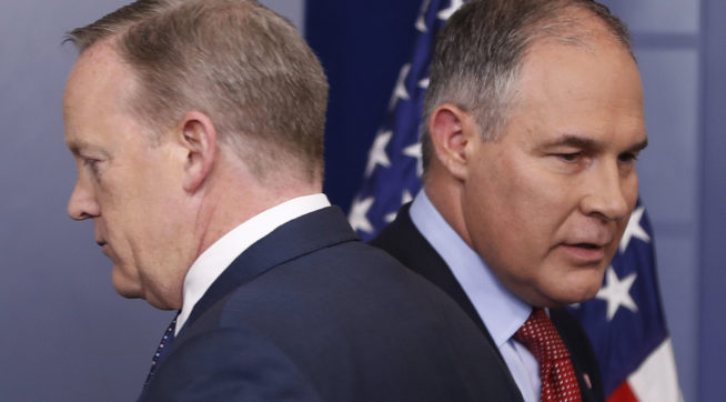 White House Press secretary Sean Spicer, left, introduces EPA Administrator Scott Pruitt, right, during the daily briefing in the Brady Press Briefing Room of the White House, Friday, June 2, 2017. (AP Photo/Pablo Martinez Monsivais)