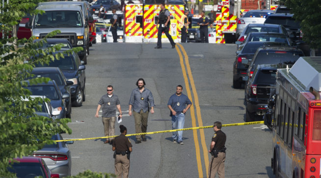 Police and emergency personnel are seen near the scene where House Majority Whip Steve Scalise of La. was shot during a Congressional baseball practice in Alexandria, Va., Wednesday, June 14, 2017.  (AP Photo/Cliff Owen)
