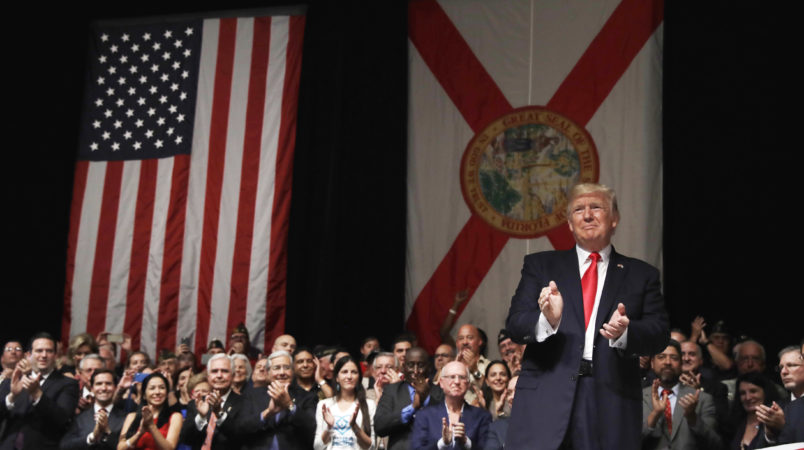 President Donald Trump delivers remarks on Cuba policy, Friday, June 16, 2017, in Miami. (AP Photo/Evan Vucci)