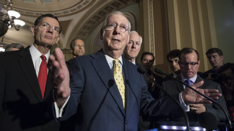 """Senate Majority Leader Mitch McConnell, R-Ky., joined by, from left, Sen. John Barrasso, R-Wyo., Sen. John Thune, R-S.D., and Majority Whip John Cornyn, R-Texas, meets with reporters following a closed-door strategy session, at the Capitol in Washington, Tuesday, June 20, 2017. Sen. McConnell says Republicans will have a """"discussion draft"""" of a GOP-only bill scuttling former President Barack Obama's health care law by Thursday. (AP Photo/J. Scott Applewhite)"""