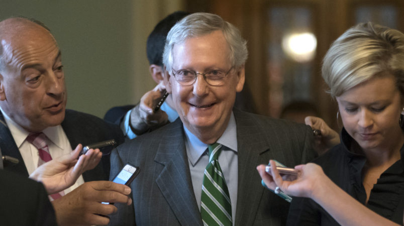 Senate Majority leader Mitch McConnell smiles as he leaves the chamber after announcing the release of the Republicans' healthcare bill which represents the party's long-awaited attempt to scuttle much of President Barack Obama's Affordable Care Act, at the Capitol in Washington, Thursday, June 22, 2017. The measure represents the Senate GOP's effort to achieve a top tier priority for President Donald Trump and virtually all Republican members of Congress.   (AP Photo/J. Scott Applewhite)