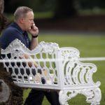 White House Press Secretary Sean Spicer talks on a phone during the Congressional Picnic on the South Lawn of the White House, Thursday, June 22, 2017, in Washington. (AP Photo/Alex Brandon)