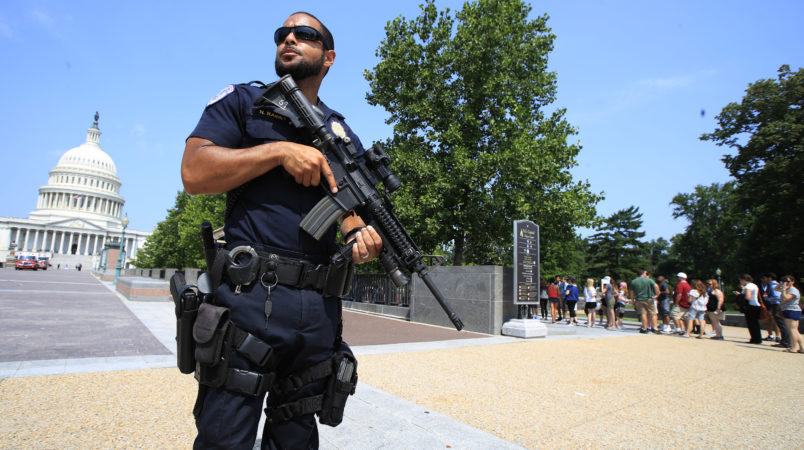 U.S. Capitol Police officer Nathan Rainey, stands guard outside the U.S. Capitol, in Washington, Wednesday, June 14, 2017, after House Majority Whip Steve Scalise of La. was shot during a congressional baseball practice. (AP Photo/Manuel Balce Ceneta)