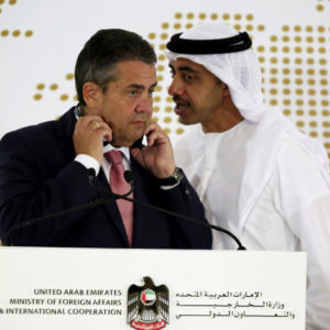 Emirati Foreign Minister Abdullah bin Zayed Al Nahyan whispers to German Foreign Minister Sigmar Gabriel during a news conference at the United Arab Emirates' Foreign Ministry in Abu Dhabi, United Arab Emirates, Tuesday, July 4, 2017. Al Nahyan met with Gabriel and talked to journalists about the ongoing diplomatic crisis engulfing Qatar. (AP Photo/Jon Gambrell)