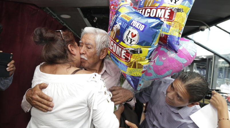 Luis Mendes Chanes, center, is reunited with his daughter Marta Mendez and her husband Luis Flores, of Queens, N.Y., aboard the Bateaux New York, in New York,  Wednesday, July 5, 2017. She had not seen him in 24 years. (AP Photo/Richard Drew)