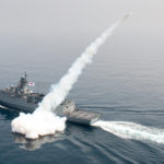 In this photo provided by South Korea Defense Ministry, a South Korean navy convoy fires a missile during a drill in South Korea's East Sea, Thursday, July 6, 2017. South Korean warplanes and navy ships have fired a barrage of missiles into the waters during one-day drills aimed at boosting a readiness against a possible North Korean aggression. (South Korea Defense Ministry via AP)
