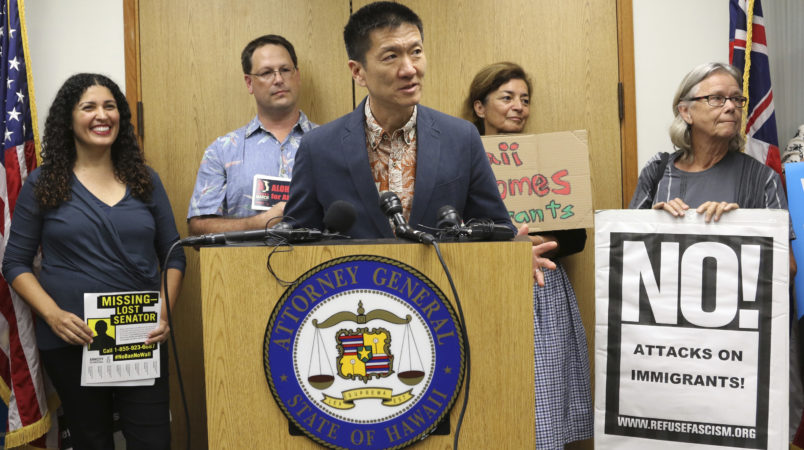 Hawaii Attorney General Douglas Chin speaks at a news conderence about President Donald Donald Trump's travel ban, Friday, June 30, 2017 in Honolulu. Chin says the scaled-back version of Trump's travel ban has illogical standards for who should be prohibited from entering the country. Chin questioned why a stepbrother or stepsister should be allowed into the country but not a grandmother. The Trump administration set new criteria Thursday barring some citizens from six majority-Muslim countering from coming to the United States. (AP Photo/Caleb Jones)