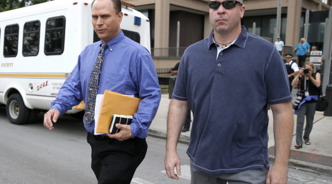 Chicago police officer Thomas Gaffney , left, and former Chicago police officer Joseph Walsh depart the Cook County Courthouse after their arraignment on state felony charges of conspiracy in the investigation of the 2014 shooting death of Laquan McDonald Monday, July 10, 2017, in Chicago. The indictment marks the latest chapter in the history of a police force dogged by allegations of racism and brutality against the city's black residents. Both pled not guilty on all charges. (AP Photo/Charles Rex Arbogast)