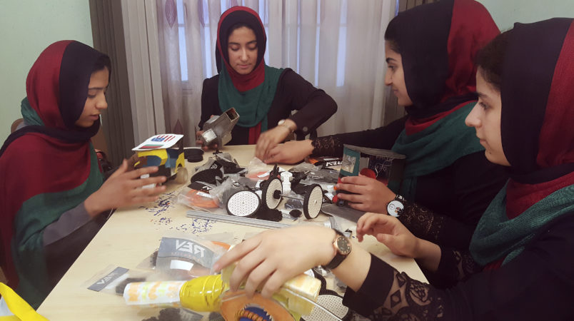In this Thursday, July 6, 2017 photo, teenagers from the Afghanistan Robotic House, a private training institute, practice at the Better Idea Organization center, in Herat, Afghanistan. Six female students from war-torn Afghanistan who had hoped to participate in an international robotics competition July 16-18 in Washington D.C will have to watch via video link after the U.S. denied them visas -- not once, but twice. Of 162 teams participating, the Afghan girls are the only nation's team to be denied visas. (AP Photos/Ahmad Seir)