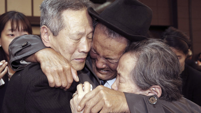 In this Oct. 22, 2015, file photo, North Korean Son Kwon Geun, center, weeps with his South Korean relatives as he bids farewell after the Separated Family Reunion Meeting at Diamond Mountain resort in North Korea. South Korea's Red Cross said on Monday, July 17, 2017, it wants separate talks at the border village on Aug. 1 to discuss family reunions. (Korea Pool Photo via AP, File) KOREA OUT