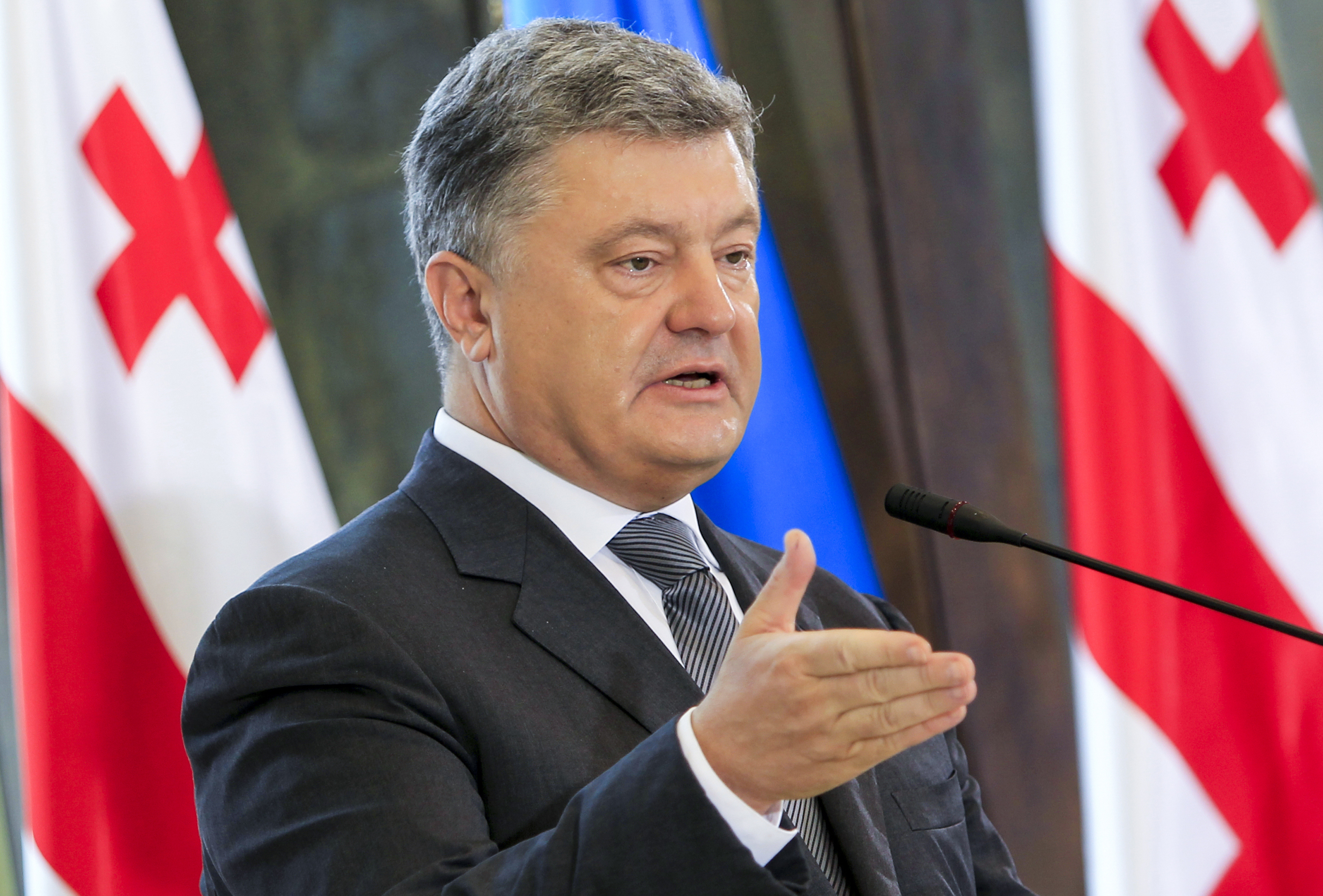 Ukrainian President Petro Poroshenko speaks at a press conference during his meeting with Georgian President Georgy Margvelashvili in Tbilisi, Georgia, 18 July 2017. Petro Poroshenko is on an official visit to Georgia.  (AP Photo/Shakh Aivazov)