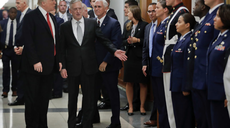 President Donald Trump and Vice President Mike Pence walk out with Defense Secretary Jim Mattis, center, to begin greeting military personnel during their visit to the Pentagon, Thursday, July 20, 2017. (AP Photo/Pablo Martinez Monsivais)