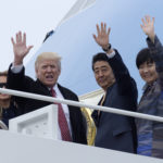 President Donald Trump and Japanese Prime Minister Shinzo Abe wave from the top of the steps of Air Force One at Andrews Air Force Base in Md., Friday, Feb. 10, 2017. Trump is hosting Abe at his estate Mar-a-Lago in Palm Beach, Fla., for the weekend. (AP Photo/Susan Walsh)Akie Abe