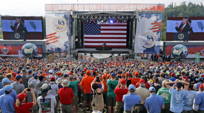 President Donald Trump waves to the crowd of scouts at the 2017 National Boy Scout Jamboree at the Summit in Glen Jean,W. Va., Monday, July 24, 2017.  (AP Photo/Steve Helber)