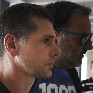 A Russian man is escorted by police officers as he  arrives at a courthouse at the northern Greek city of Thessaloniki, on Wednesday, July 26, 2017. Greek authorities say they have arrested a Russian man wanted in the United States on suspicion of masterminding a money laundering operation involving at least $4 billion through bitcoin transactions. (AP Photo/Giannis Papanikos)