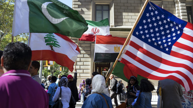 Marchers carry the national flags of Pakistan, top left, Lebanon, bottom left, Iran, top center, Egypt, bottom center and the American flag, right, during the Muslim Day Parade on Madison Ave. Sunday, Sept. 25 2016, in New York. (AP Photo/Craig Ruttle)