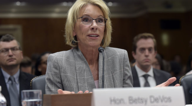 AGs sue DeVos for delaying for-profit college rules
