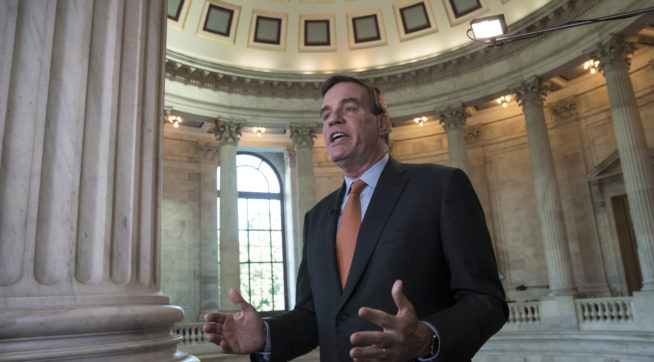 Senate Intelligence Committee Vice Chairman Sen. Mark Warner, D-Va., answers questions during a TV news interview at the Capitol in Washington, Tuesday, June 20, 2017.  (AP Photo/J. Scott Applewhite)