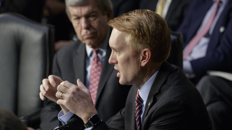 Sen. James Lankford, R-Okla., joined by Sen. Roy Blunt, R-Mo., rear, questions witnesses as the Senate Intelligence Committee conducts a hearing on Russian intervention in European elections in light of revelations by American intelligence agencies that blame Russia for meddling in the 2016 U.S. election, on Capitol Hill in Washington, Wednesday, June 28, 2017.  (AP Photo/J. Scott Applewhite)