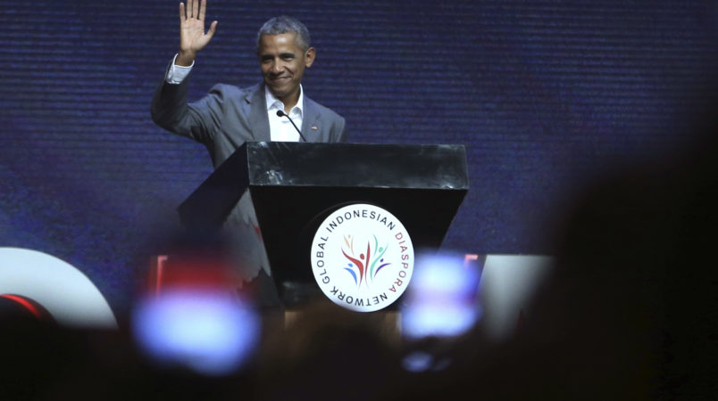 Former U.S. President Barack Obama waves prior to delivering his speech during the 4th Congress of Indonesian Diaspora Network in Jakarta, Indonesia, Saturday, July 1, 2017. (AP Photo/Achmad Ibrahim)