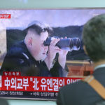"""A man walks by a TV screen showing a news program reporting about North Korea's missile firing with an image of North Korean leader Kim Jong Un, at Seoul Train Station in Seoul, South Korea, Tuesday, July 4, 2017. North Korea on Tuesday claimed it successfully test-launched its first intercontinental ballistic missile, a potential game-changing development in what may be the world's most dangerous nuclear standoff and, if true, a direct rebuke to U.S. President Donald Trump's earlier declaration that such a test """"won't happen!"""" (AP Photo/Lee Jin-man)"""