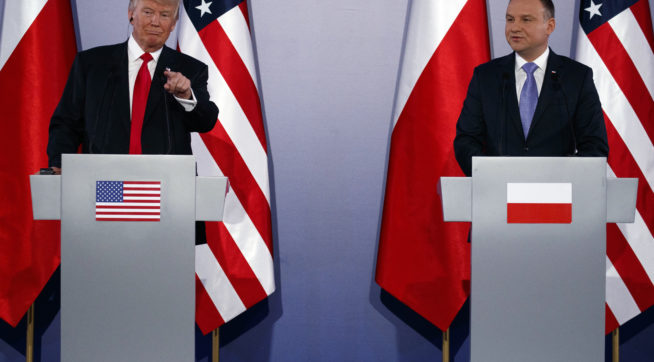 President Donald Trump points to a reporter during a news conference with Polish President Andrzej Duda at Royal Castle, Thursday, July 6, 2017, in Warsaw. (AP Photo/Evan Vucci)