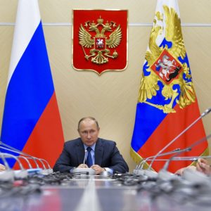 Russian President Vladimir Putin,  center, chairs a meeting of the Commission for Military Technology Cooperation at the Novo-Ogaryovo residence outside Moscow, Russia, Thursday, July 6, 2017.  (Alexei Druzhinin, Sputnik,  Kremlin Pool Photo via AP)