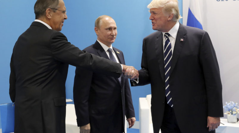U.S. President Donald Trump, right, greets Russian Foreign Minister Sergey Lavrov, left, prior his talks with Russian President Vladimir Putin, center, during the G20 summit in Hamburg Germany, Friday July 7, 2017. (Mikhail Klimentyev, Kremlin Pool Photo via AP)