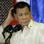 Philippine President Rodrigo Duterte scratches his head during his speech at the ceremonial turnover to the Armed Forces of the Philippines at the Malacanang presidential palace in Manila, Philippines Tuesday, July 18, 2017. Duterte asked Congress on Tuesday to extend martial law in the southern third of the country until the end of the year, saying the rebellion there will not be quelled by July 22, the end of his 60-day martial law proclamation.(AP Photo/Aaron Favila)