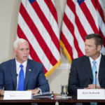 Vice President Mike Pence, left, accompanied by Vice-Char Kansas Secretary of State Kris Kobach, right, speaks during the first meeting of the Presidential Advisory Commission on Election Integrity at the Eisenhower Executive Office Building on the White House complex in Washington, Wednesday, July 19, 2017. (AP Photo/Andrew Harnik)