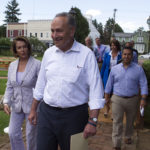 "Senate Minority Leader Chuck Schumer of N.Y. and House Minority Leader Nancy Pelosi of Calif. lead Congressional Democrats to a news conference to unveil their new agenda, Monday, July 24, 2017, in Berryville, Va. House and Senate Democrats are offering a retooled message and populist agenda, promising to working Americans ""someone has your back.""  (AP Photo/Cliff Owen)"