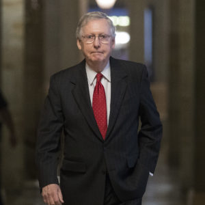 Senate Majority Leader Mitch McConnell of Ky., walks from his office en route to the Senate floor on Capitol Hill in Washington, Wednesday, July 26. (AP Photo/Carolyn Kaster)