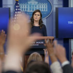 Reporters raises their hands as White House press secretary Sarah Huckabee Sanders answers question during the press briefing in the Brady Press Briefing room of the White House in Washington, Wednesday, July 26, 2017. (AP Photo/Pablo Martinez Monsivais)