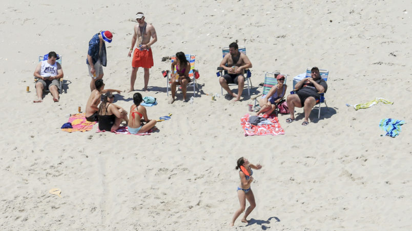 NJ Gov. Chris Christie (right) and his family enjoy a picture perfect Sunday afternoon at the beach on Island Beach State Park, which is closed to the public due to the state government shutdown.  7/2/17  (Andrew Mills | NJ Advance Media for NJ.com)