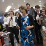 Sen. Lisa Murkowski, R-Alaska, heads to the chamber for a vote, on Capitol Hill in Washington, Thursday, July 20, 2017. Majority Leader Mitch McConnell is spurring Republican senators to resolve internal disputes that have pushed their marquee health care bill to the brink of oblivion, a situation made more difficult for the GOP because of Sen. John McCain's jarring diagnosis of brain cancer. (AP Photo/J. Scott Applewhite)