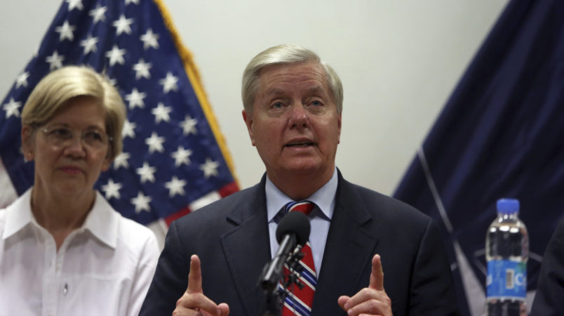 U.S. Senator Lindsey Graham right, speaks during a press conference at Resolute Support headquarters in Kabul, Afghanistan, Tuesday, July 4, 2017, (AP Photo/Rahmat Gul)