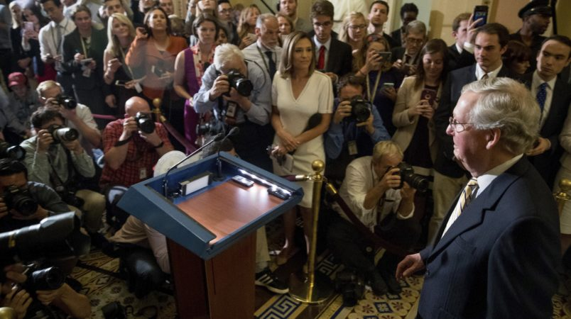 Senate Majority Leader Mitch McConnell of Ky. arrives to speak to reporters outside the Senate Chamber on Capitol Hill in Washington, Tuesday, July 25, 2017. A vote has passed to take up debate on the health care bill. (AP Photo/Andrew Harnik)