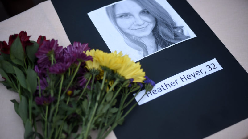 A portrait of Heather Heyer, who was killed when a vehicle drove through counter protestors in Charlottesville, Va., lies on on a table with flowers at the Vigil Against Hate held on the campus of the University of Southern Mississippi in solidarity with the counter protesters killed and injured against the White Nationalists in Charlottesville, Va., in Hattiesburg, Miss. Monday, Aug 14, 2017 (Courtland Wells   Vicksburg Post, via AP)