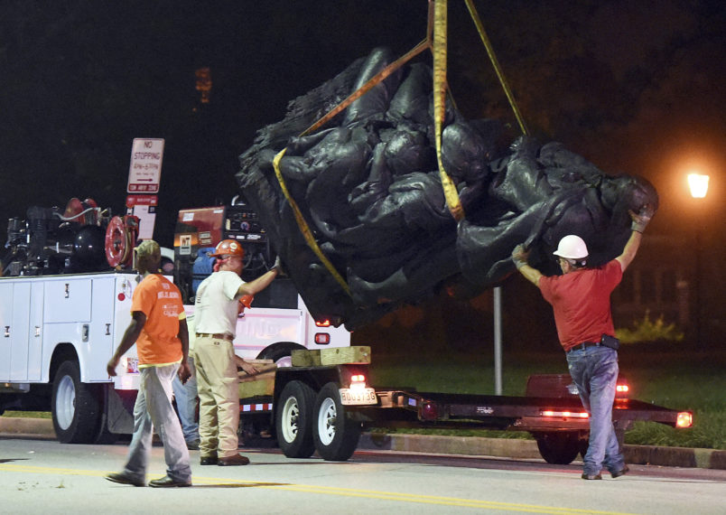 Workers remove a monument dedicated to the Confederate Women of Maryland near the intersection of Charles St. and University Parkway early Wednesday morning. (Jerry Jackson/Baltimore Sun)