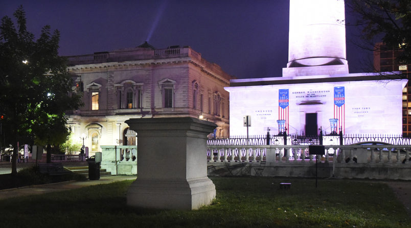 The empty pedestal of the  former U.S. Supreme Court Justice Roger B. Taney is seen before dawn in Mount Vernon after workers took four Confederate monuments overnight in the city. (Jerry Jackson/Baltimore Sun)
