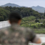 "A South Korean soldier watch the north side at the Imjingak Pavilion in Paju, South Korea, Wednesday, Aug. 16, 2017. China has urged the United States and North Korea to ""hit the brakes"" on threatening words and work toward a peaceful resolution of their tense standoff created by Pyongyang's recent missile tests and threats to fire them toward Guam. The dispute has also raised fears in South Korea, where a conservative political party on Wednesday called for the United States to bring back tactical nuclear weapons to the Korean Peninsula. (AP Photo/Lee Jin-man)"