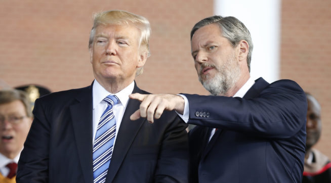 President Donald Trump stands with Liberty University president, Jerry Falwell Jr., right, during commencement ceremonies at the school in Lynchburg, Va., Saturday, May 13, 2017. (AP Photo/Steve Helber)